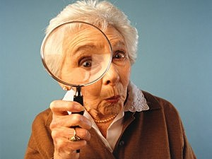 Old Woman with Magnifying Glass