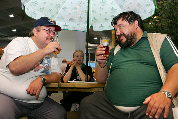 two men working on their beer bellies